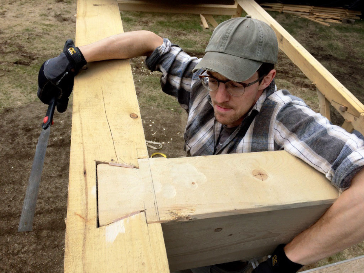 Assembling a timber frame dove tail joint